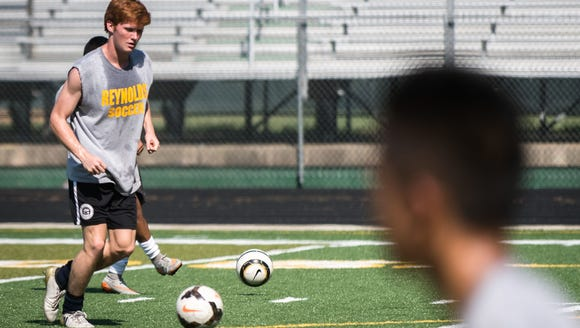 Izaiah Vignali, of the Reynolds High School soccer team, runs through drills during practice.