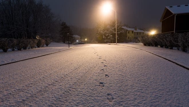 Footprints in the snow at 1am on Saturday in Howell, NJ.