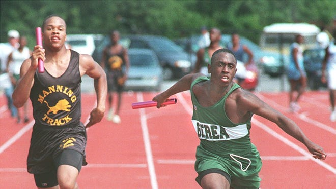 Larry Griffin, right, won the Class AAA state championship in the 100-meter dash at Berea in 2000. He'll be inducted into the school's Hall of Fame with four others Friday night.