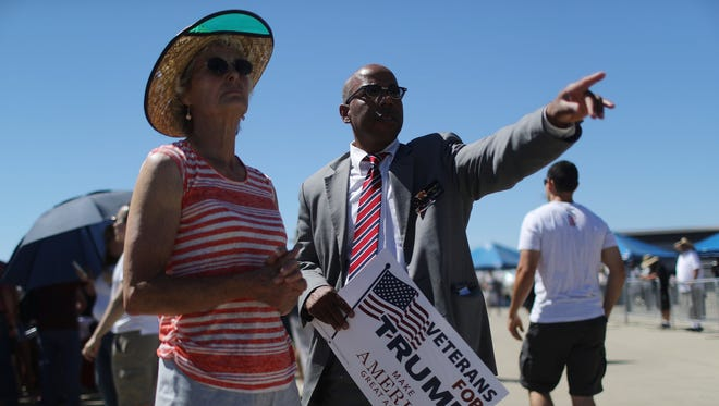 "Gregory Cheadle, right, was singled out by Donald Trump during his visit to Redding in June 2016 as ""my African-American over there."""