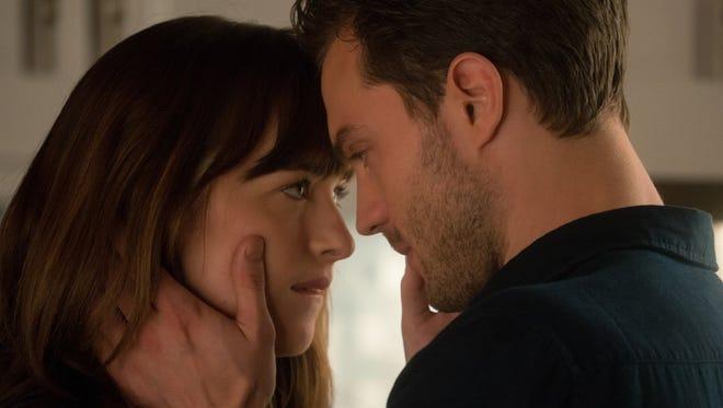 "Dakota Johnson and Jamie Dornan in ""Fifty Shades Darker."""