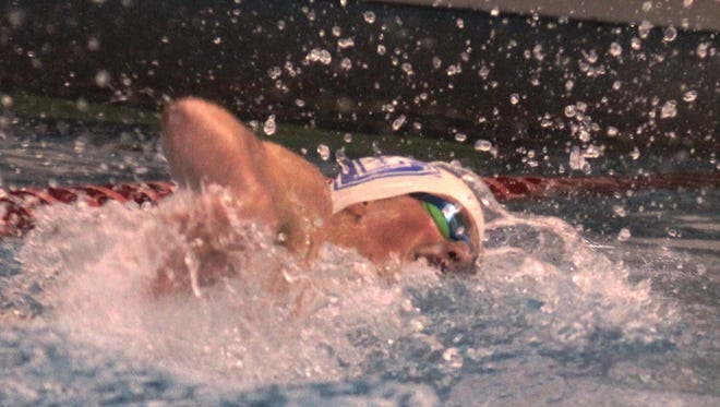 Covington Catholic senior Nick Smith swims the 200 freestyle, where he finished in second place.