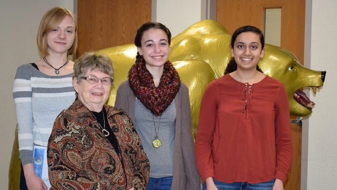 From left, Kathy Fridrich, Dorothy Bachman (below), Alyssa Dudinyak and Sana Malik. Bachman, president of the GFWC Tri-Cities Women's Club, awarded the writers certificates in the club's Youth Poetry and Short Story contest.