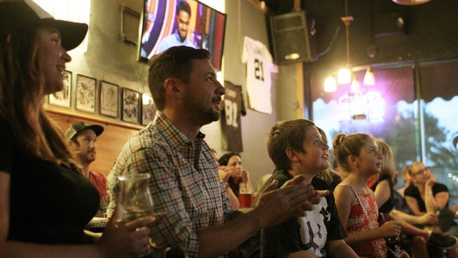 """Brien O'Brien, center, competed in the cooking show """"MasterChef"""" and hosted a viewing party at Maxwell's Eatery on Wednesday night."""