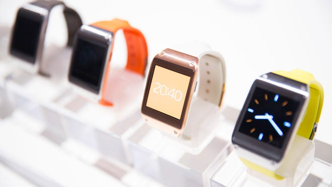 New Samsung Galaxy Gear in different colors are on display after the presentation in Berlin.