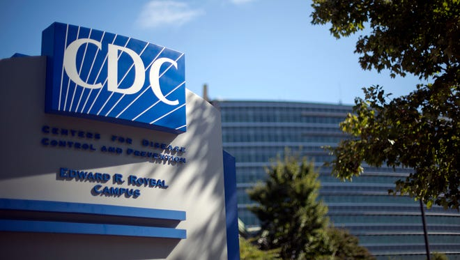 A sign marks the entrance to the federal Centers for Disease Control and Prevention on Oct. 8, 2013 in Atlanta.
