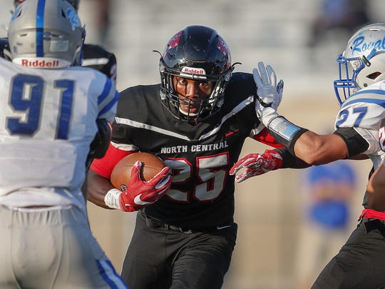 North Central running back George Stokes (25) and the Panthers go for their fourth win of the season against Center Grove.