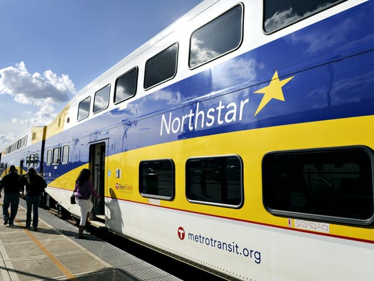 Passengers board a Northstar train at the Big Lake
