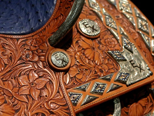 A saddle made by artist John Rule is displayed in his