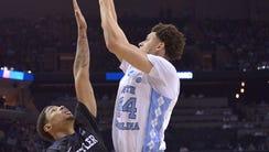 North Carolina forward Justin Jackson (44) shoots against