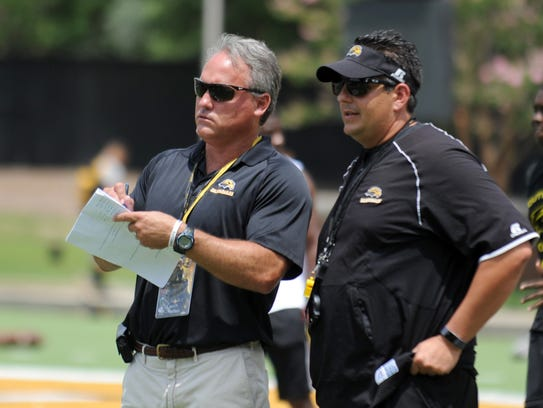 Former Southern Miss defensive coordinator Tony Pecoraro, right, accepted the same position at Florida Atlantic Tuesday.