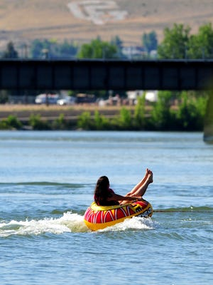 A tube rider has fun on the Missouri River on Broadwater Bay. The average high temperature for Great Falls in July was 92.6.