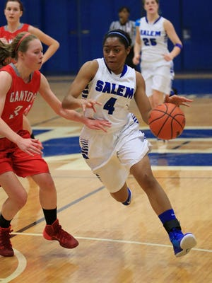 Salem's Jamyra Wilson (right) dribbles against a Canton player during a game from last season. She is one of the team's top returnees.