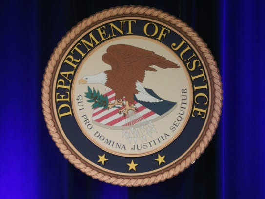 The Justice Department seal.