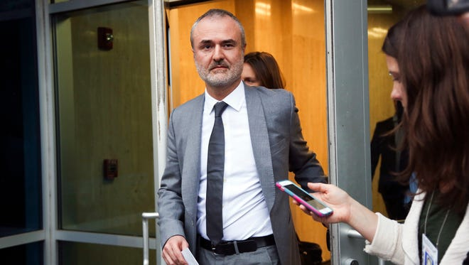 Gawker founder Nick Denton walks out of the courthouse in St. Petersburg, Fla. Gawker.com is going to shut down after its parent company was sold to Univision.