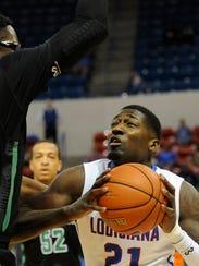 Louisiana Tech forward Merrill Holden goes up for a
