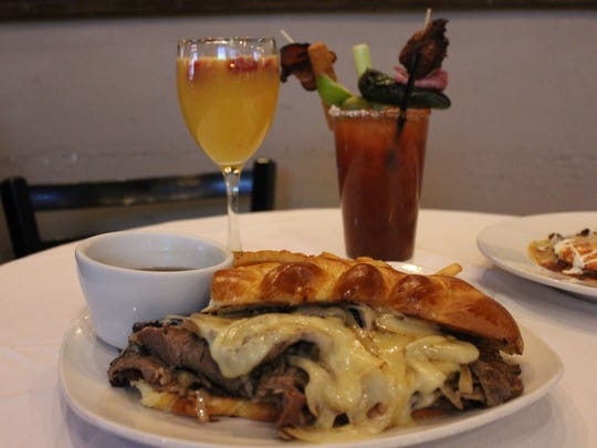 The Prime Rib Sandwich, served with a side of au jus and french fries, from the brunch menu at Pecan Grill and Brewery, 500 S. Telshor Blvd. Also featured is the PGB Mimosa and the Six Feet Under Bloody Mary.