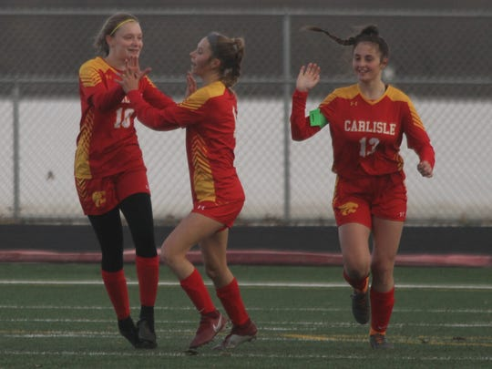 Carlisle freshman Mady Taylor is congratulated by team