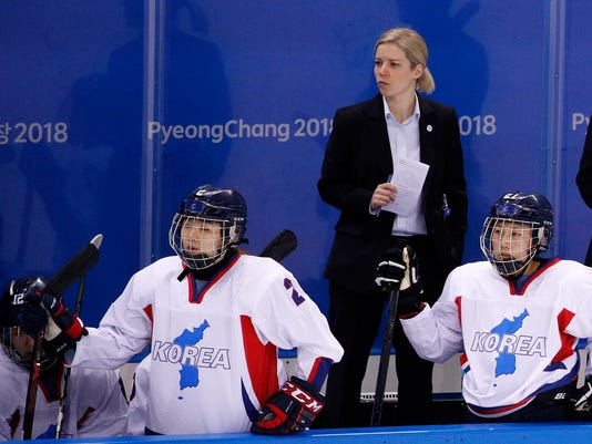 FILE - In this Feb. 10, 2018, file photo, head coach Sarah Ruth Murray, of the combined Koreas team, watches during the second period of the preliminary round of the women's hockey game against Switzerland at the 2018 Winter Olympics in Gangneung, South Korea. The Canadian, who doesn't turn 30 until April, signed up four years ago for her first coaching job to guide South Korea through its Olympic debut at the Pyeongchang Games. A challenging enough task even before negotiations turned her hockey team into a political experiment with South and North Korea adding 12 North Koreans only days before the games began. (AP Photo/Jae C. Hong, File)