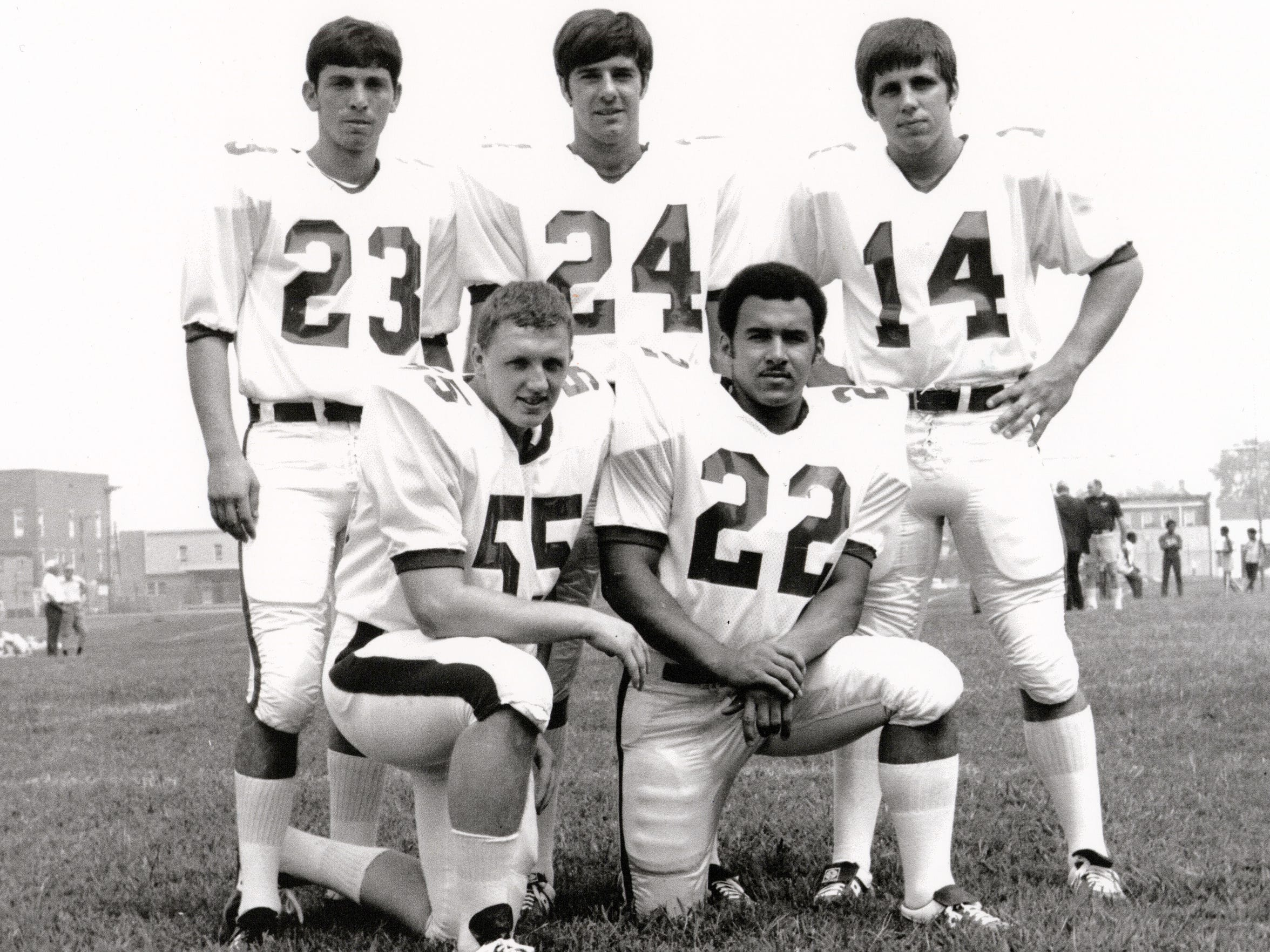 """The 1970 Marshall University football team had five players from New Jersey. Dennis Foley (55) is the only one who didn't die in the Nov. 14, 1970 plane crash. Pictured are, back row: Marcelo Lajterman (23), Kevin Gilmore (24), Ted Shoebridge (14) front row: Dennis Foley (55), Arthur """"Art"""" Harris (22)"""