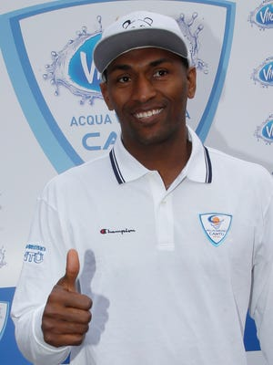 Former NBA All-Star Metta World Peace gives the thumbs-up sign prior to a news conference in Milan, Italy, on Thursday, March 26, 2015.