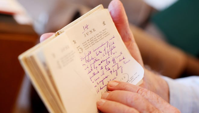 James Q. Salter holds a diary that he wrote in during his time serving with the U.S. Air Force during WWII at his home in Stuarts Draft on Wednesday, May 25, 2016. Salter is the only living member of his original bomber crew.