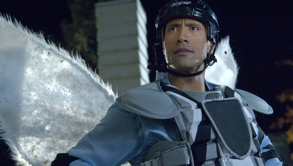 "Dwayne Johnson is a hockey goon-turned-hero in ""The Tooth Fairy."""