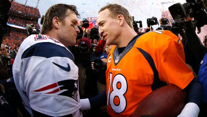 Peyton Manning #18 of the Denver Broncos and Tom Brady #12 of the New England Patriots speak after the AFC Championship game at Sports Authority Field at Mile High on January 24, 2016 in Denver, Colorado. The Broncos defeated the Patriots 20-18.