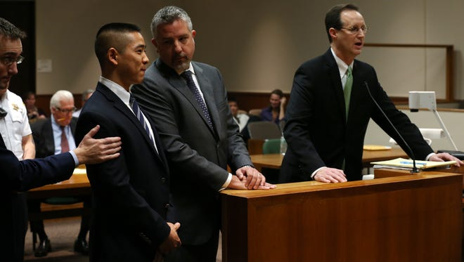 Charles Tan listens on Thursday as Judge James Piampiano orders that the case be dismissed.