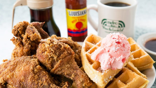 Metro Diner's fried chicken and waffle features a Belgian waffle topped with powdered sugar and sweet, strawberry butter.