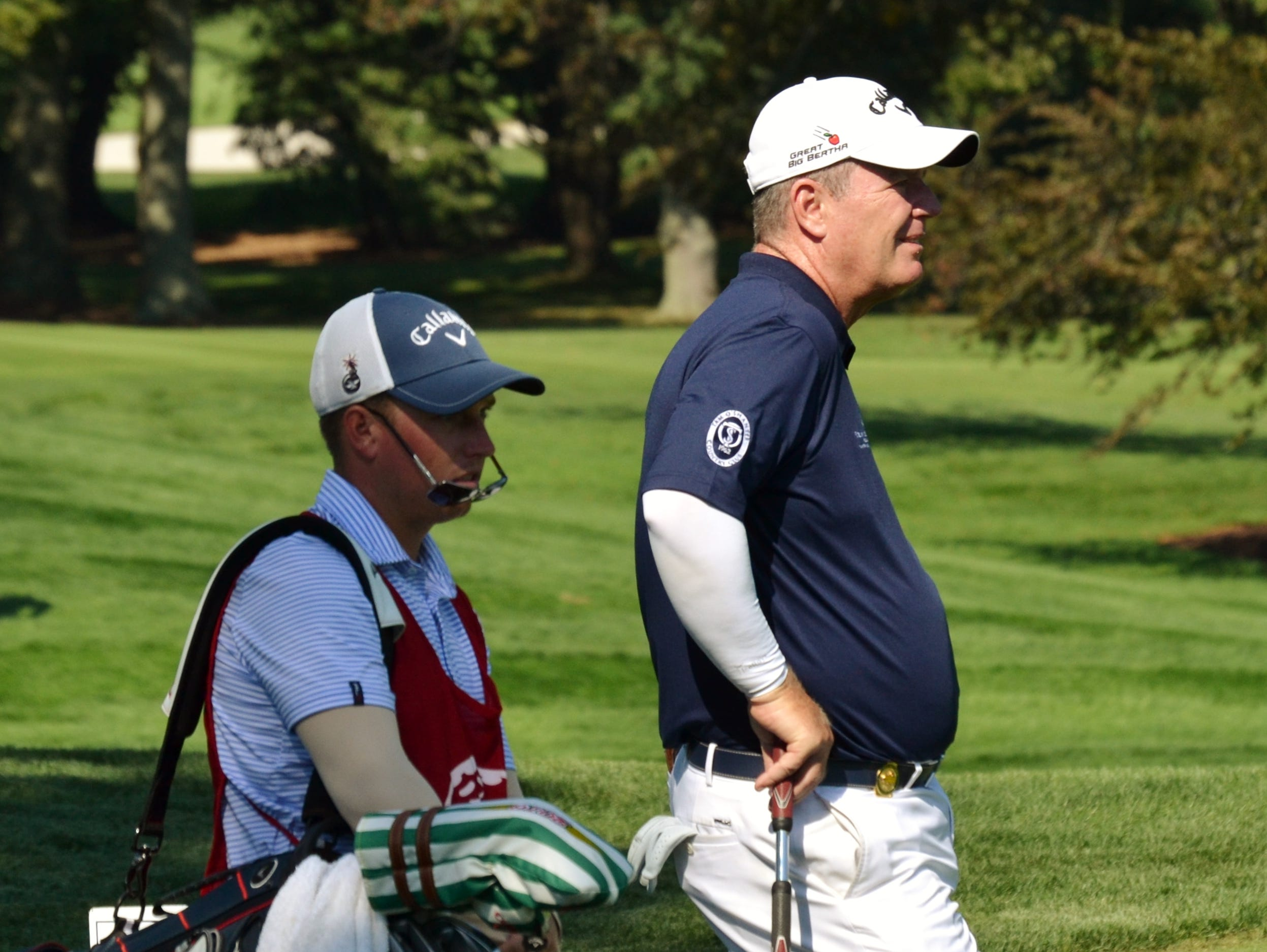 Met Open champion Mark Brown waits to tee off Wednesday at the 17th hole at Glen Oaks with caddie Josh Rackley. The Tam O'Shanter head pro also won the Met Open in 1999 and 2013.