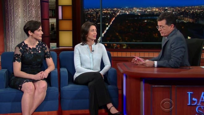 Moira Demos (left) and Laura Ricciardi speak with Stephen Colbert.