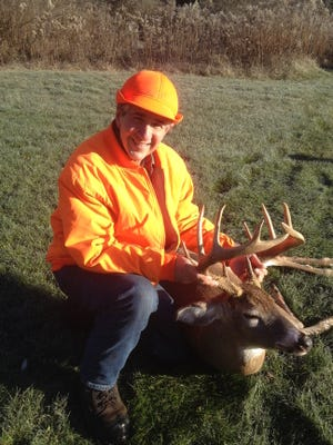Mitrick with an 11-point buck he shot in Tioga County in 2015.