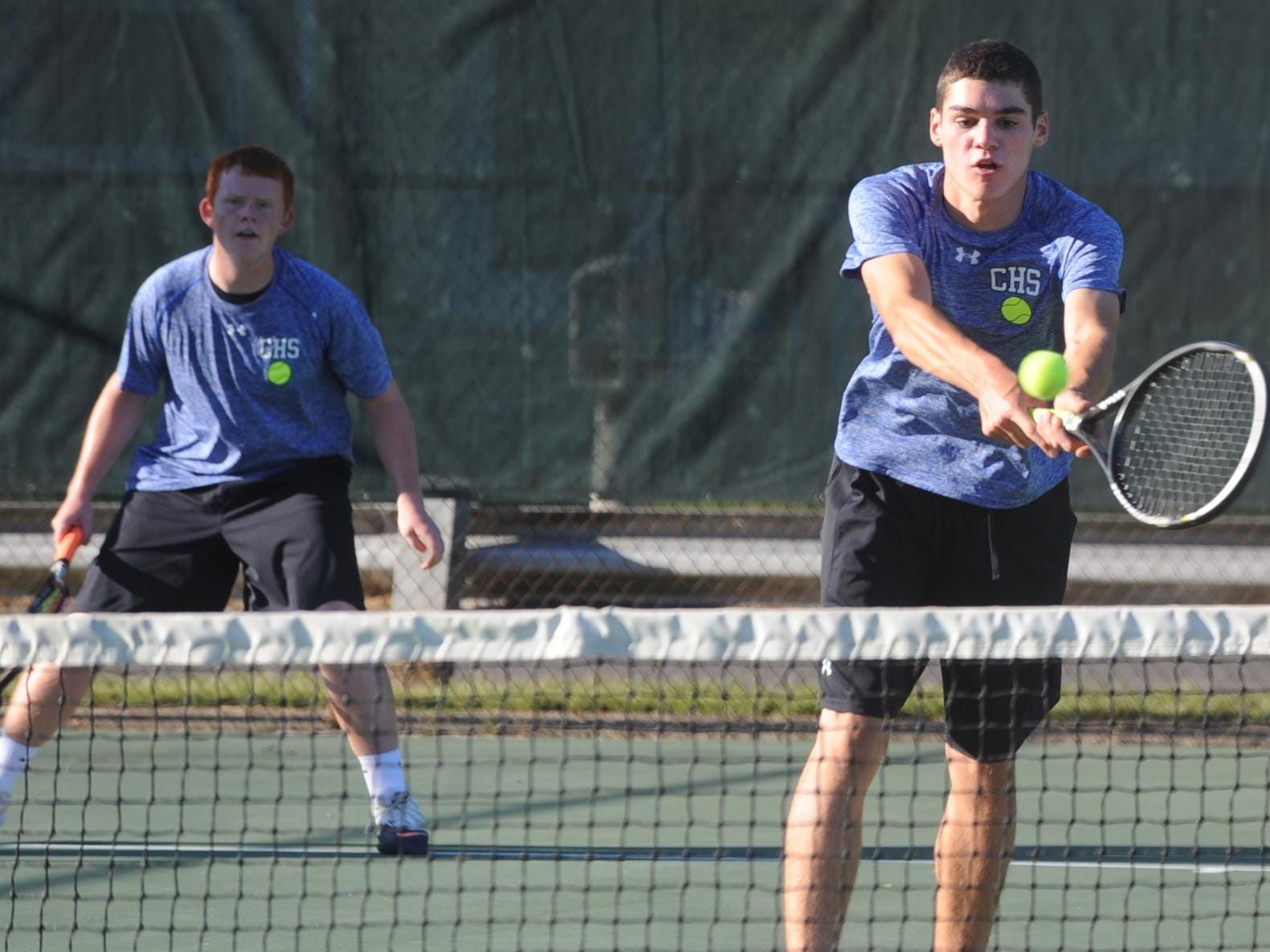 Centerville's Skyler Benedict returns the ball while No.1 doubles teammate Blake Shook looks on Monday against Lincoln.