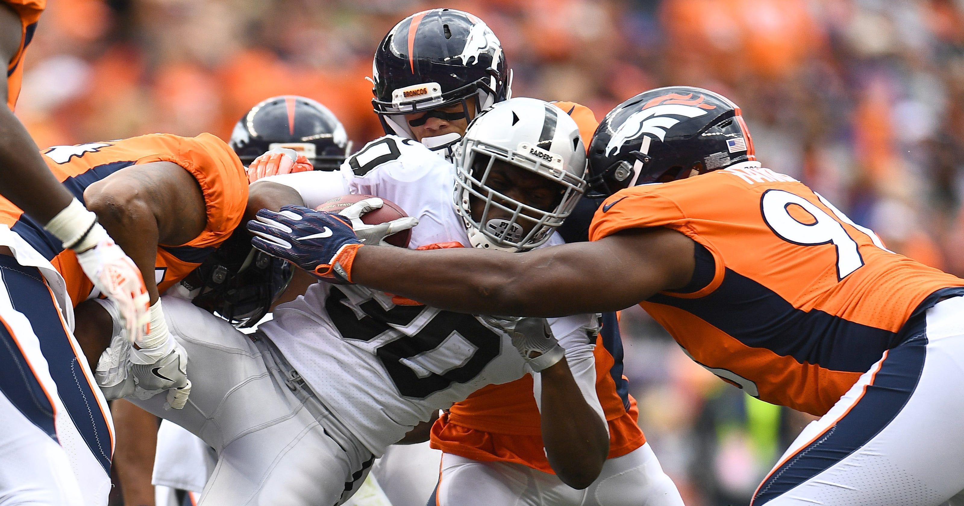 dfd69f0a349 Broncos  defense swarms Raiders in bounceback win