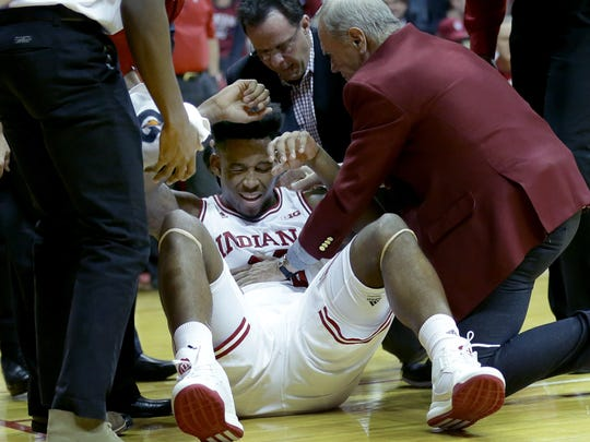 Indiana Hoosiers forward De'Ron Davis (20) is helped up after taking a hit from Purdue Boilermakers center Isaac Haas (44) in the second half of their game Thursday, February 9, 2017, evening at Assembly Hall in Bloomington IN. The Purdue Boilermakers defeated the Indiana Hoosiers 69-64.