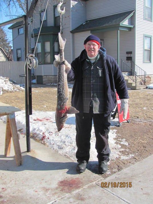 Werner spears sturgeon on his birthday in Oshkosh