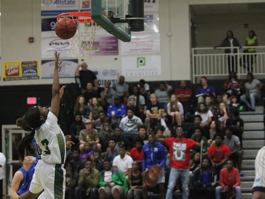 Courtney Mack goes up for a layup during Lincoln's