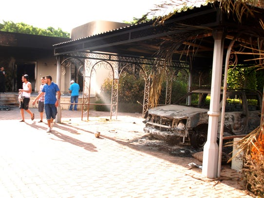 Libyans walk on the grounds of the gutted U.S. consulate in Benghazi, Libya, after an attack that killed four Americans, including Ambassador Chris Stevens, Wednesday, Sept. 12, 2012. The American ambassador to Libya and three other Americans were killed when a mob of protesters and gunmen overwhelmed the U.S. Consulate in Benghazi, setting fire to it in outrage over a film that ridicules Islam's Prophet Muhammad. Ambassador Chris Stevens, 52, died as he and a group of embassy employees went to the consulate to try to evacuate staff as a crowd of hundreds attacked the consulate Tuesday evening, many of them firing machine-guns and rocket-propelled grenades.(AP Photo/Ibrahim Alaguri)