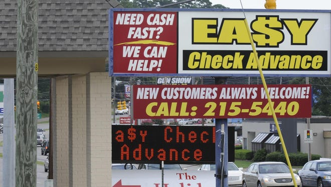 Payday loan stores seen in Montgomery in 2014. A new database tracking loans across the state found Alabamians are taking out $14 million in payday loans each week.