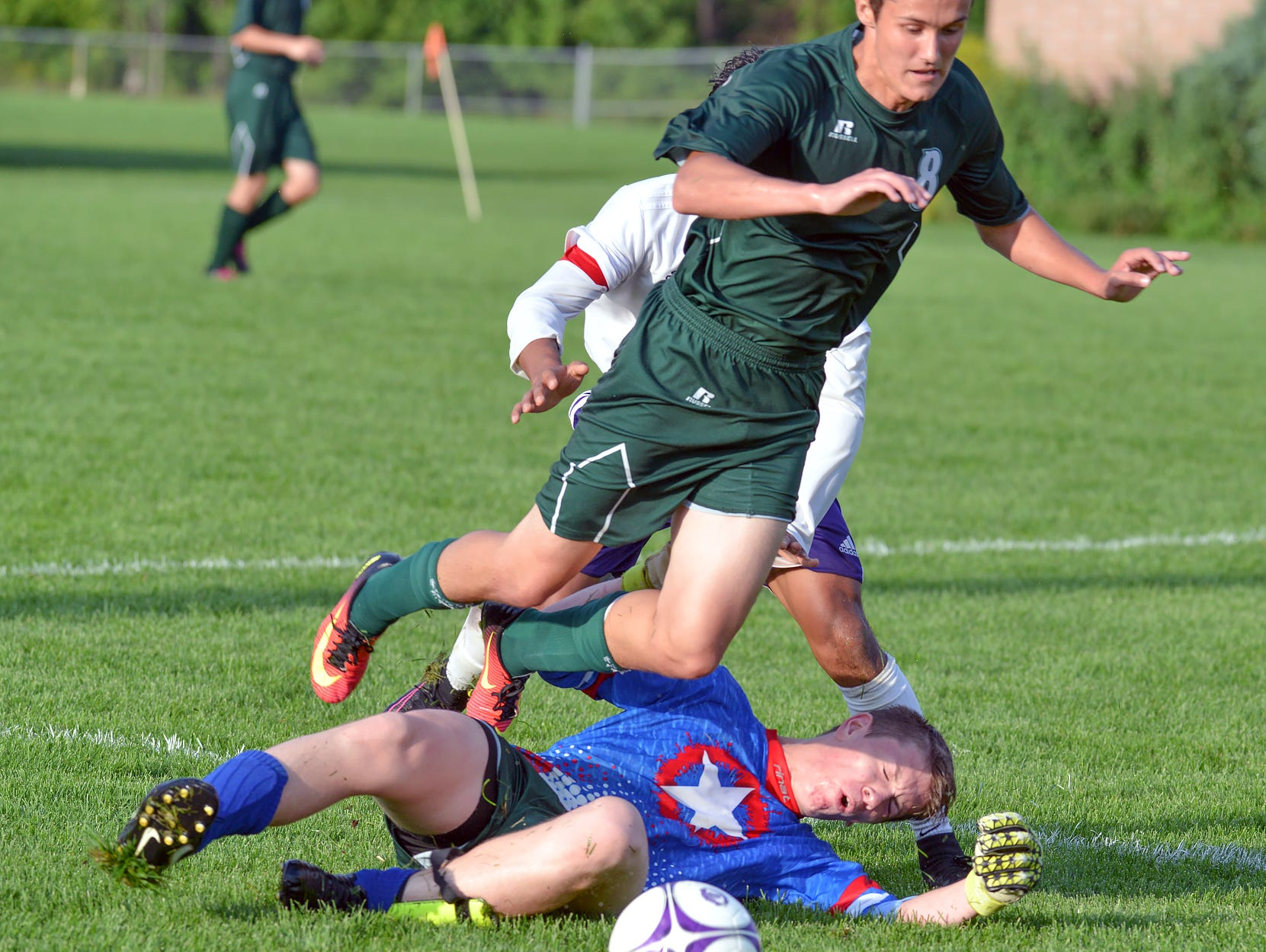 Pennfield goalkeeper Keith Browand slides for the ball during game action Wednesday night.