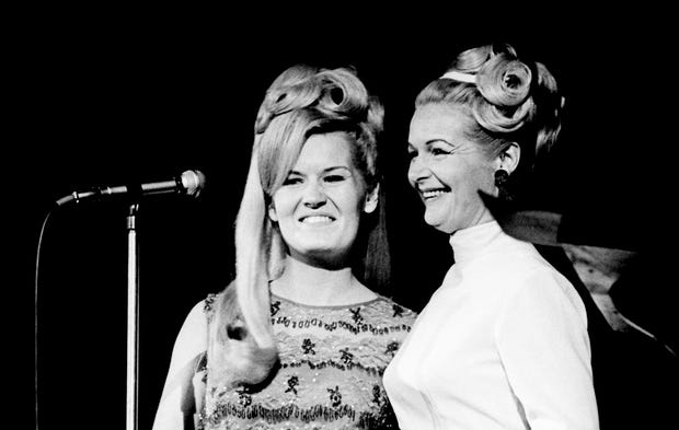 """Lynn Anderson, left, and her mother, Liz Anderson, stand before the microphone at RCA Victor's Opry breakfast Oct. 22, 1967. Singer and writer Liz Anderson told the audience she wasn't going to sing, but just wanted to introduce her daughter, who appears on """"The Lawrence Welk Show."""""""