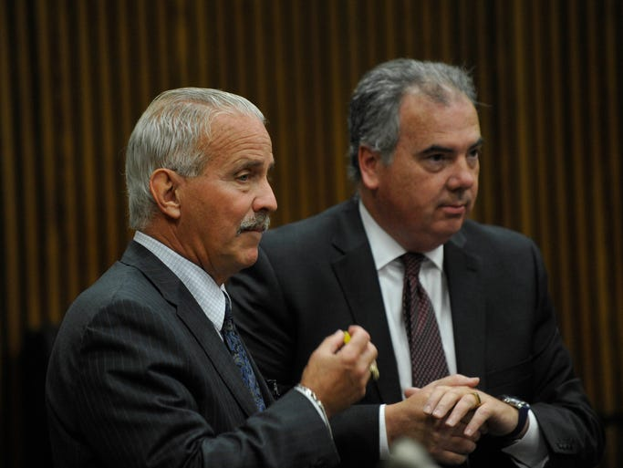 Officer Joseph Weekley's defense attorney Steve Fishman, left, talks before court begins to Robert Morgan, assistant prosecutor, on Monday, Sept. 29, 2014. Weekley is accused of involuntary manslaughter in the death of  Aiyana Stanley Jones, 7, during a police raid at her home.