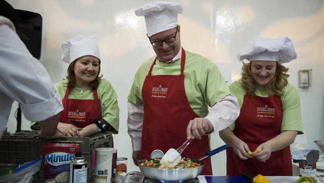 Vicki Zaslausky, Christopher Warren and Alison Manny (from left) compete in the Food Bank of South Jersey's Hunger Games last  year.