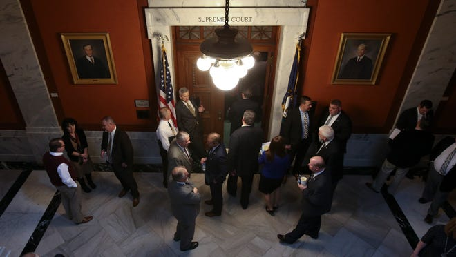 Members of the House walk into a caucus session at the state Capitol in Frankfort.  Feb. 20, 2018