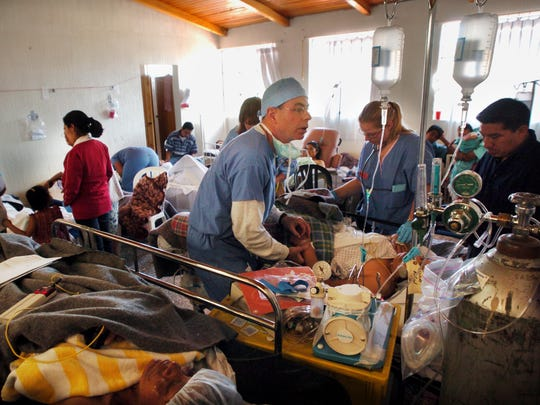 HELPS medical staffers look after patients during a clinic in Guatemala in 2005.