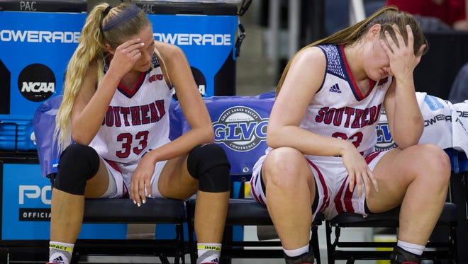 With the game out of reach, Southern Indiana's Kaydie Grooms (33) and Hannah Wascher spend the last minutes of their game against Indianapolis on the bench at the Great Lakes Valley Conference tournament at the Ford Center Friday night.