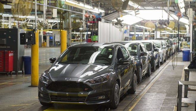 This January 7, 2015 file photo shows a lineup of Ford Focus vehicles on an assembly line at the Ford Michigan Assembly Plant in Wayne, Michigan.