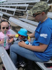 Kyla Bagienski sits with her kids Amyla B., 2, and