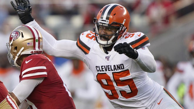 Cleveland Browns defensive end Myles Garrett (95) sacks San Francisco 49ers quarterback Jimmy Garoppolo during the first half of an NFL football game in Santa Clara, Calif., Monday, Oct. 7, 2019.